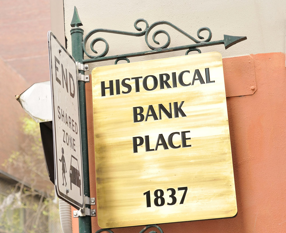 Metro Apartments on Bank Place Historical Sign