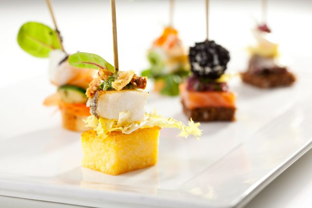 32216855 - seafood and vegetables canapes over white